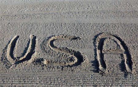 big WORD USA United States of America on the sand of the beach Stock Photo