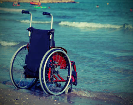 Wheelchair on the shore with vintage style effect