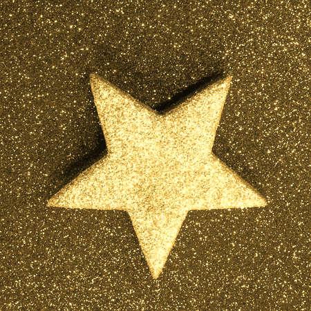 lone great golden star on golden background