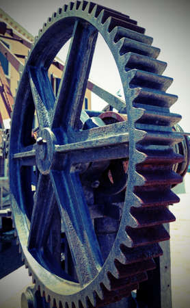 great gear wheel of a gear for lifting loads in the shipyard with vintage effect