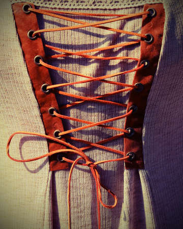 intertwining with the string of an ancient medieval dress with vintage effect Stock fotó