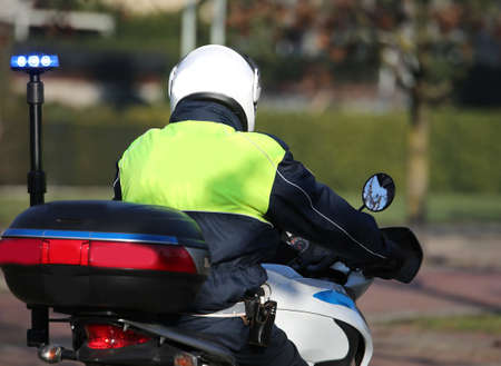 policeman on a motorcycle patrolling the streets of an Italian city