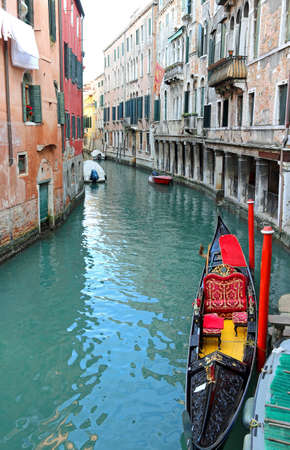 Venice Italy the water way called CANALE in Italian Language and a black gondola Imagens