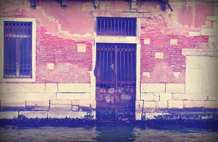 Broken Door in the Grand Canal called Canal Grande in Venice Italy with vintage effect