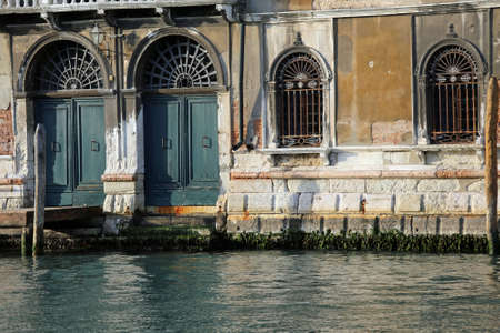 Ancient Palace in Canal Grand in Venice during low tide in winter