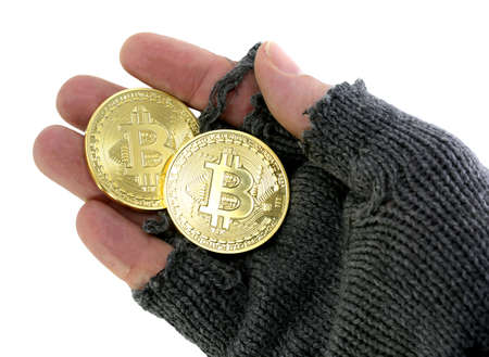 concept of the risk of virtual currency with hand of poor man holding BitCoin coins on white background Stock Photo