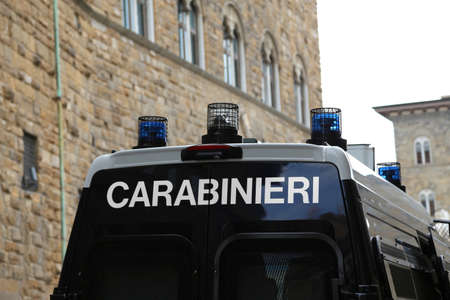 car of the carabinieri italian police with sirens co in the background an ancient palace