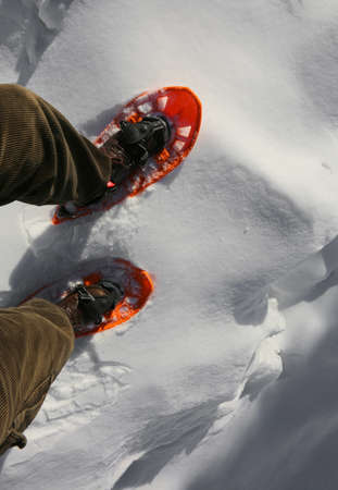 man with snowshoes near a crevasse in winter Stock Photo