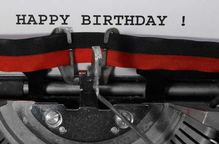 Happy Birthday written with the old typewriter on white sheet Stock Photo