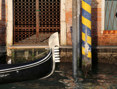 bow of a gondola in the Grand Canale in Venice Italy called Canal Grande in Italian Language
