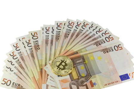 Many 50 euro banknotes and the golden BitCoin coin on white backjground