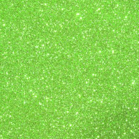 Green shimmering glittered background with glittering lights