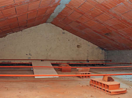 empty attic of the house with sloping roof