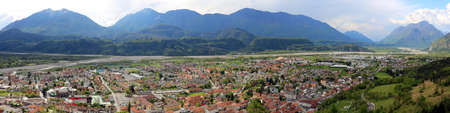 wide panorama of Town called Tolmezzo and the Valley of Tagliamento River in Northern Italy Stock Photo