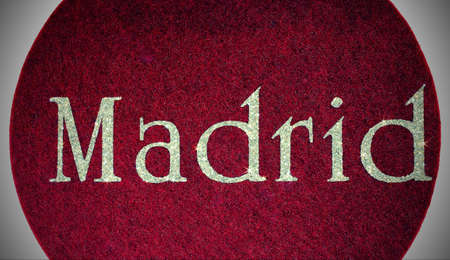 Madrid written of a Spanish city on fabric background Stock Photo