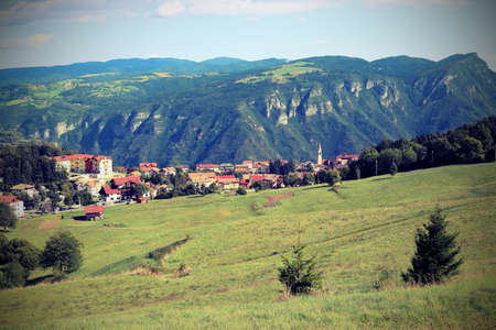 panorama of the village called Tonezza del Cimone in Italy in middle of nature with vintage effect