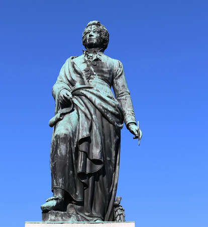 statue of the great composer Mozart with the background of the sky