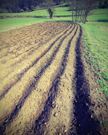 vegetable garden plow to perfection when it is sown in the spring from the farmer with vintage effect