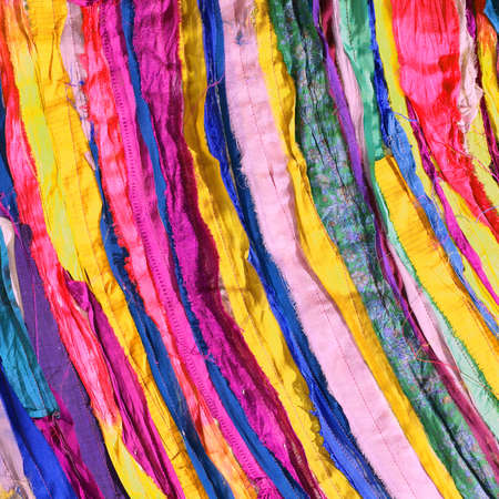 colored background of many fabrics of cotton and synthetic