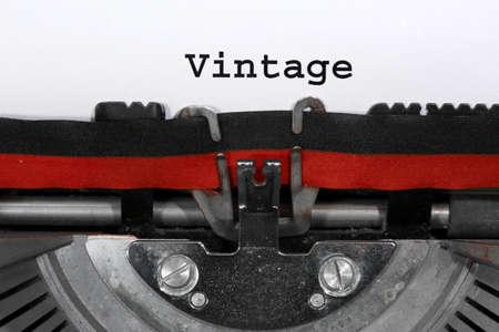 Text VINTAGE written with the typewriter on white sheet Archivio Fotografico - 96275631