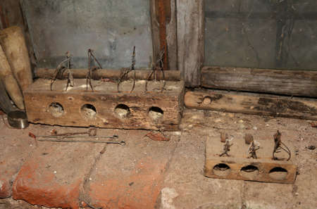 two old rat traps made of worm-eaten wood