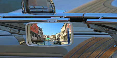 rearview mirror of the boat in the canal of an island