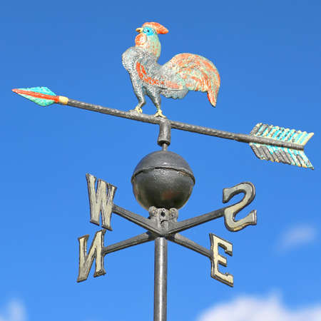 weathervane with cock above an arrow and the four cardinal points North East West South