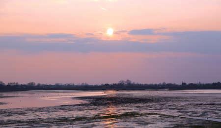 sundown on water of venetian lagoon at winter