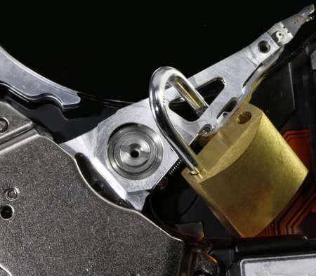 hard disk of a computer with an open padlock as a concept for computer data security Banco de Imagens