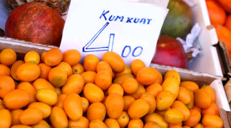 fresh orange kumkuat a tropical fruit for sale at greengrocer store