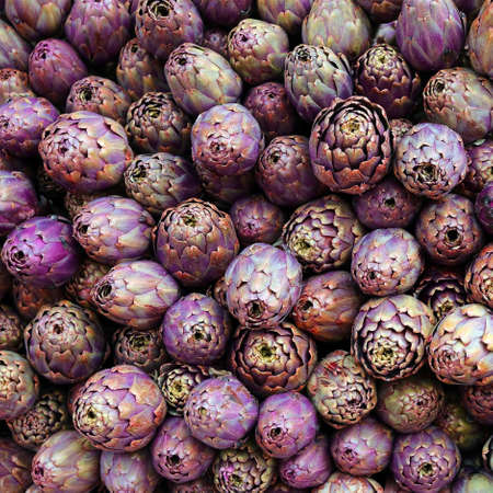background of ripe artichokes for sale in Southern Italy market