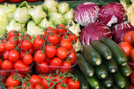 many fruits and vegetables for sale at local market