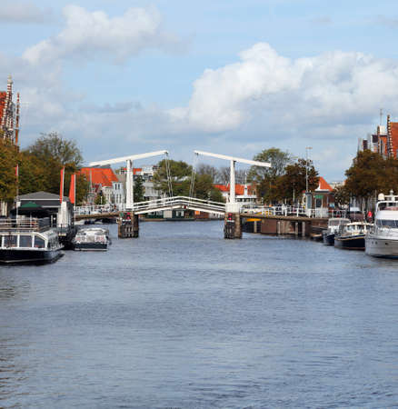raised drawbridge to let ships pass through the Dutch city of Harlem Stock Photo