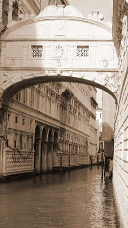 famous bridge of sighs with artistic sepia effect and the waterway