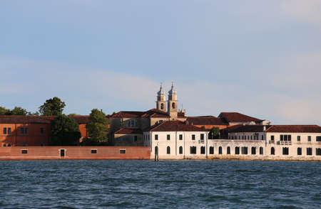 Venice Italy Buildings of the Benedictines in San Servolo Island in the Venetian Lagoon. Benedictine monks lived from at least the eighth century and for five hundred years.Later the hospital was used to care for the mentally ill. Banco de Imagens