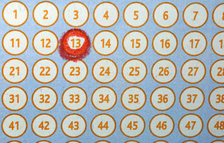 Many numbers and the number 13 circled in red on a bingo card lottery Stock Photo