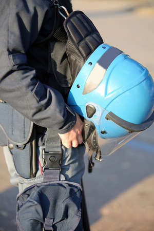 blue helmet of a policeman riot cop during the uprising in the city Stock Photo