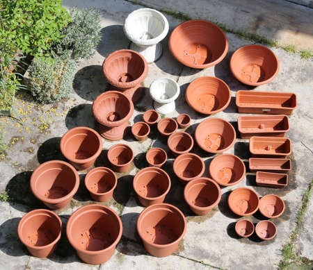 many plastic vases that look like terracotta for sale in the florists shop Фото со стока