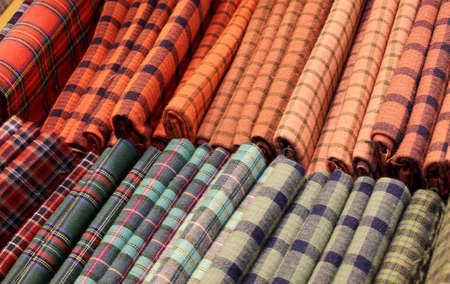 Scottish tartan fabrics for sale in the haberdashery with high quality products Banco de Imagens