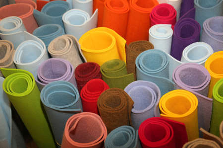 many colored rolls of fabric in the store