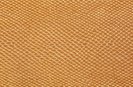 golden background of scales similar to snakeskin