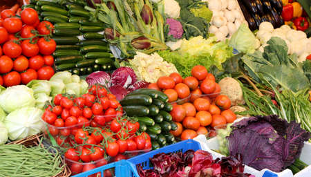 many fresh vegetables and fruits for sale Stockfoto