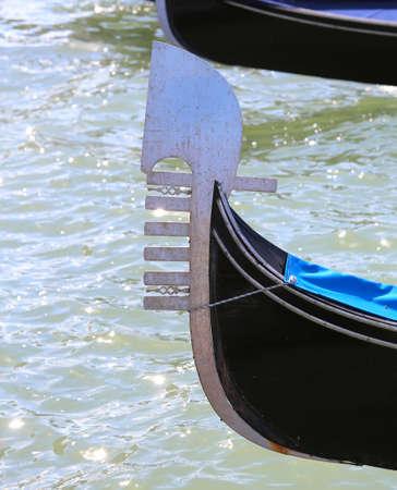 bow of Venice gondola in the adriatic sea Stock Photo - 98968755