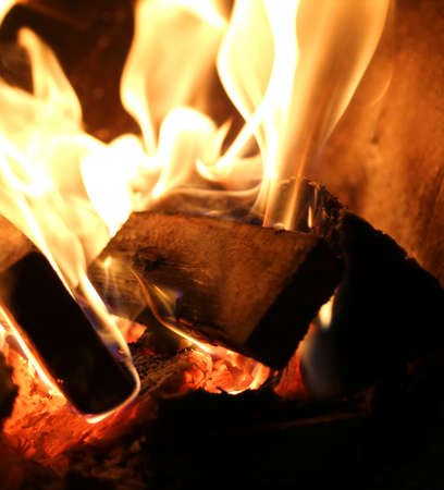 fire flames made with pieces of dried wood inside the kitchen stove Stock Photo