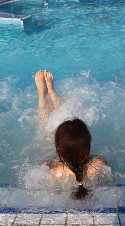 young woman during the hydromassage session in the spa pool Stock Photo