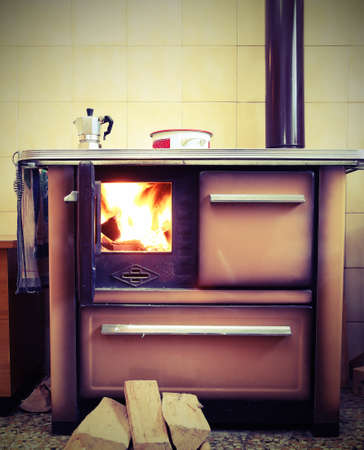 vintage stove with fire in the house with retro effect Stock Photo