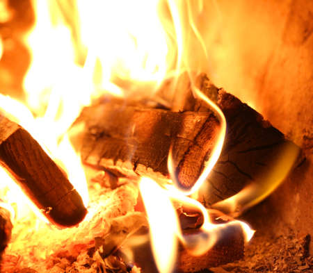 burnt pieces of wood with flames and fire
