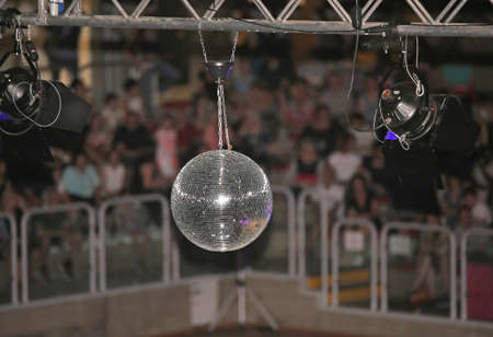 Big disco ball at the concert that reflects light directed at it in many directions Stock Photo