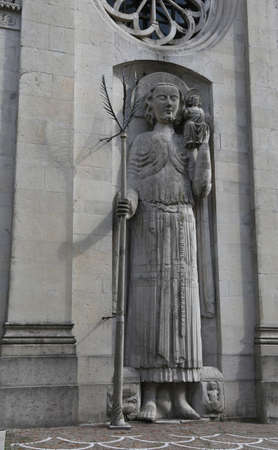 statue of Saint Christopher of ancient Cathedral in Gemona del Friuli in Northern Italy.