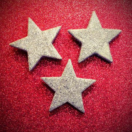 large silver stars on red illuminated background
